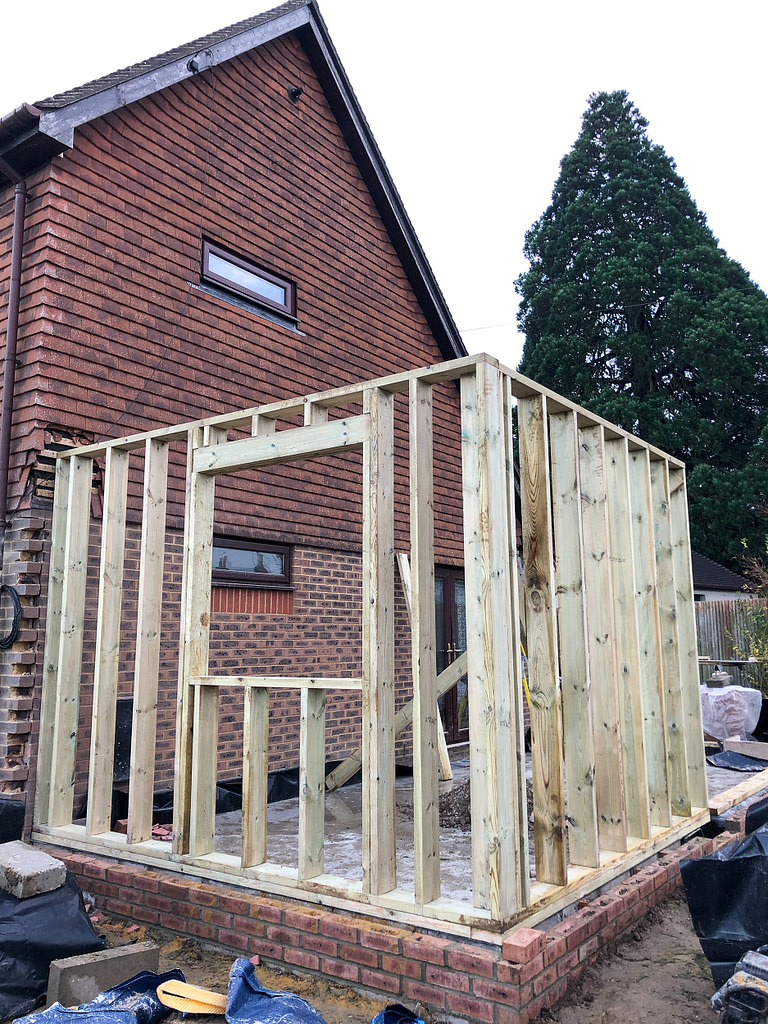 Photo showing the beginnings of the timber frame
